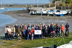 Libby Alexander from SOS-C, centre, with John Nelson, chairman of Chichester Harbour Trust, and concerned residents at Dell Quay for the launch of SOS-C