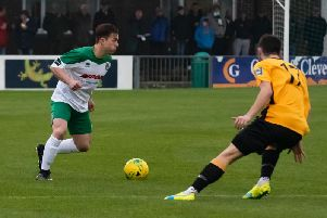 Calvin Davies on the ball against Three Bridges before his knee injury struck / Picture by Tommy McMillan