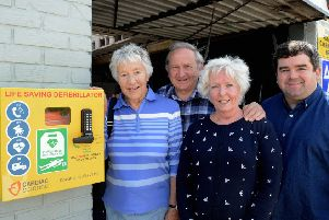 Val Holt, Alyn Miller, Sue Miller and Steve Carruthers with the new defibrillator in Pagham