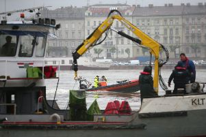 Hungarian authorities search for remains from a tourist boat that capsized on the Danube river last night (Photo by David Balogh/Getty Images)