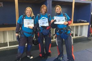 Emma Fox, Nicki Rowe and Iwona Hynek after completing the sky dive