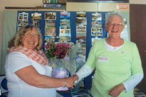 Sussex West Federation chairman Yvonne Price presenting Deirdre (right) with a bouquet from the Westergate WI members
