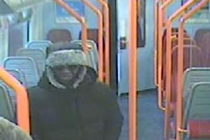A CCTV image of Darren Pencille on the train