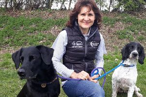 Heathlands Reunited dog ambassador Sam Walsh with her hounds