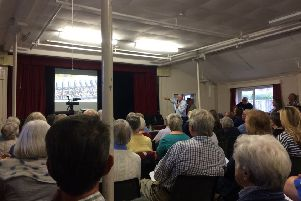 Jono Oswin gives a presentation to a public meeting in Funtington over issues of odours from a pig farm outside the village