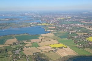 An aerial photograph of the top of Chichester Harbour and the A259 corridor
