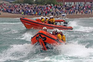 Lifeguard service pictured in their life saving boats