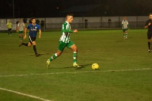Josh Clack on the ball in Chi City's draw with Burgess Hill / Picture: Neil Holmes