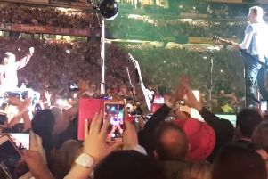 WATCH: Disabled Coldplay fan crowdsurfs in wheelchair to Croke Park stage - helped by Chris Martin