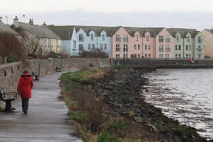 A hardy walker makes the best of the weather in Killyleagh before a forecasted cold snap moves in on Monday