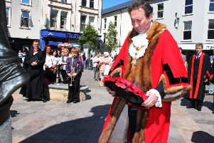 The then-Coleraine mayor, David Harding, lays a wreath at a service in 2013 marking the 40th anniversary of the IRA bomb