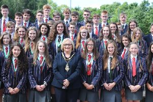 Coleraine Grammar School Rowing Team pictured with the Mayor of Causeway Coast and Glens Borough Council, Councillor Brenda Chivers, Dr David Carruthers, Coleraine Grammar School principal, Jeremy Johnston, Head Rowing Coach and Ross Cochrane, Assistant Rowing coach.