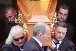 William Dunlop's family, including his brother Michael (back right) carry his coffin from the church after the funeral