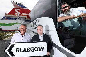 DRIVING GROWTH: Aodh Hannon (left) of Hannon Coach has revealed plans to expand the companys direct luxury coach service between Belfast and Glasgow to other towns across Northern Ireland. He is pictured with Stena Line's Ian Baillie (centre) and driver Jim McAlorum.