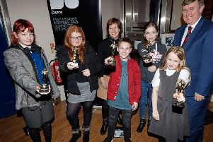 Terry Burns (BBC Children in Need - centre back row) and Mervyn Storey MLA (back right) with performers from 'The People I know' with their awards at the showing of 'The People I Know' at Ballymoney Town Hall, 29th January 2019.