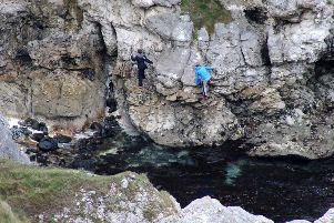 Youths scaling cliffs unaided without any safety equipment  at Kenbane near Ballycastle at the weekend.  PICTURE KEVIN MCAULEY/MCAULEY MULTIMEDIA