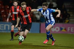 Crusaders Ross Clarke   and Coleraine's Stephen Lowry