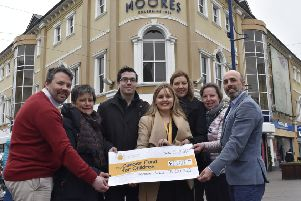 Simon Fisher, Thelma Wray, Nathan Chapman, Suzanne Conkey, Lorraine and Simon Colquhoun from Ulster Stores/Moores present Suzanne o'Loughlin (Regional Fundraiser Cancer Fund for Children) with  �13,447.44 from their 2018 charity partnership.