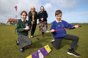 Amelia Michalska from St Patrick's Primary School Portrush and Paul Fletcher from Portrush Primary School are joined on Royal Portrush Golf Club green by Moira Doherty, Deputy Secretary, Department for Communities and Mayor of Causeway Coast and Glens Borough Council Brenda Chivers as they launch the Legacy Primary Schools Golf Programme ahead of this year's 148th Open