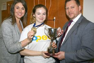 Abigail Reilly with Sarah Travers (left), MC of the Skillbuild NI competition, and Barry Nielson (right) Chief Executive of Construction Industry Training Board Northern Ireland