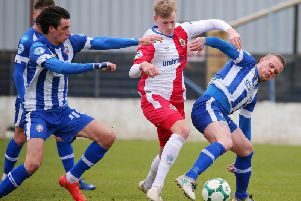 Coleraine's Aaron Canning and Jamie Glackin tussle with Linfield's Benjamin Nielsen.