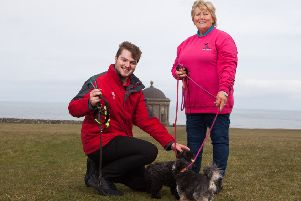 Chairman of Causeway Coast Dog Rescue charity Mrs Margaret Dimsdale-Bobby, with some of the rescue dogs, along with Andrew King of the National Trust, enjoying a leisurely walk at Mussenden Temple while raising awareness of the importance of having dogs on leads at this location.