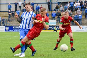 Coleraine's James McLaughlin is fouled