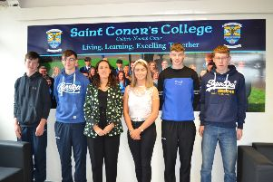Students who received A* grades with Mrs Aine Bradley (Principal) are Caitlin McGuigan, John Campbell, Aidan McAleese, Martin Mayberry and Eoghan McAtamney. Missing from the photo is Caoimhe Robinson and Lois O'Kane