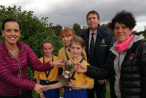 Emma Young is presented with the Mary McCabe trophy by Loreto College Vice Principal Mr S Gallagher, along with runners-up and Ms Wilson and Mrs McCullough of the PE Department