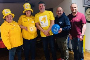 From left - Representatives from Marie Curie; Steve Whyte, Bridge Bar manager; Adrian Friel of Causeway branch of Alzheimers Society, Daren McColgan Chairman of Portstewart MUSC