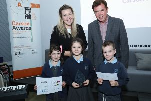 Children from Carhill Integrated Primary School with principal, Samantha'Russell, receive their Carson Prize from Tony Carson at a ceremony at the Ormeau Baths, Belfast