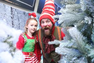 Olivia Hamill with a elf at the North Coast Post Office