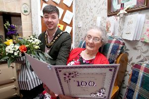 Mayor of Causeway Coast and Glens Borough Council congratulates Margaret Gillan on her 100th birthday at her home in Armoy