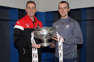 Crusaders boss Stephen Baxter (left) and Coleraine manager Oran Kearney with the BetMcLean League Cup trophy. Pic by Pacemaker.