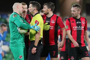Crusaders players appeal against the decision by referee Ian McNabb to award Coleraine a penalty kick. Pic by Pacemaker.