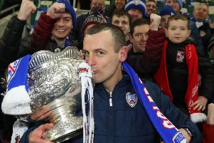 Coleraine boss Oran Kearney with the trophy in front of the vocal supporters. Pic by INPHO.