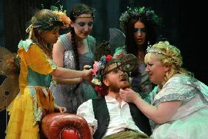 Bottom (Tom Hounsham) with Titania (Tess Kennedy) and the fairies. Picture by Sam Taylor