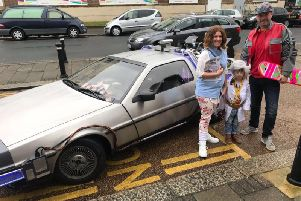 Jessica barber , William Barber and their son William Barber Junior, 5, dressed as Doc Brown. Picture: Jessica Barber