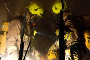 Firefighters helped one person get clear of the flames. Pictures and video: Eddie Howland