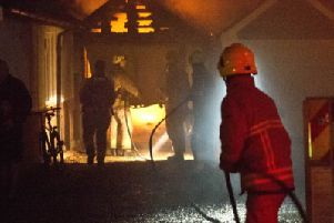 Firefighters spent the evening  battling a garage blaze in Hassocks.