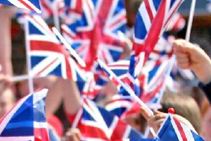 Flags will be waved across the area on the day of the royal wedding