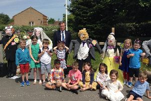 Henry Smith MP with children at The Brook School