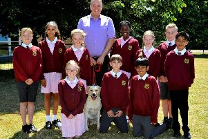 Headteacher Anthony White with some of his pupils and Poppy the school dog