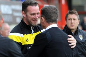 Crawley Town boss Harry Kewell and then Notts County manager Kevin Nolan embrace on the touchline last season. Picture by Steve Robards. SR1723053
