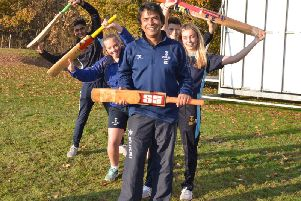 The founder of First Class Cricket Academy Raj Chaudhuri with pupils at Worth School, near Crawley.
