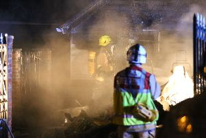 Firefighters tackle a caravan fire in Horsham SUS-181223-104448001