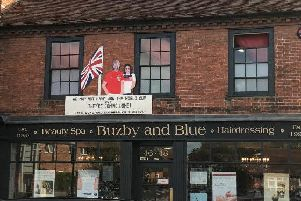 Royal visit artwork outside of Buzby and Blue Salon