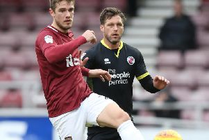 Timi Elsnik of Northampton Town controls the ball watched by Dannie Bulman of Crawley Town during the Sky Bet League Two match (Photo by Pete Norton/Getty Images)