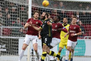 Joe McNerney attempts to head the ball under pressure during the Sky Bet League Two match between Northampton Town and Crawley Town. (Photo by Pete Norton/Getty Images)