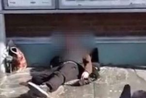 The video of the homeless man being sloshed with water went viral on Twitter. Picture: BBC News